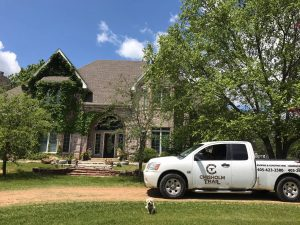 Roofer Truck in Front of House with Puppy