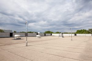 Flat Commercial Roof Could Benefit from Silicone Roof Coatings