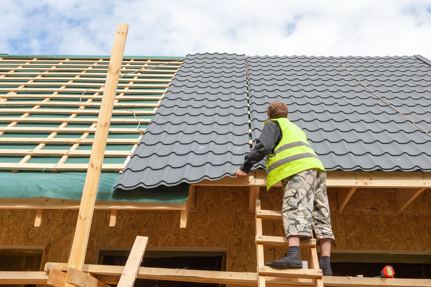 Roofer Installing Metal Roofing